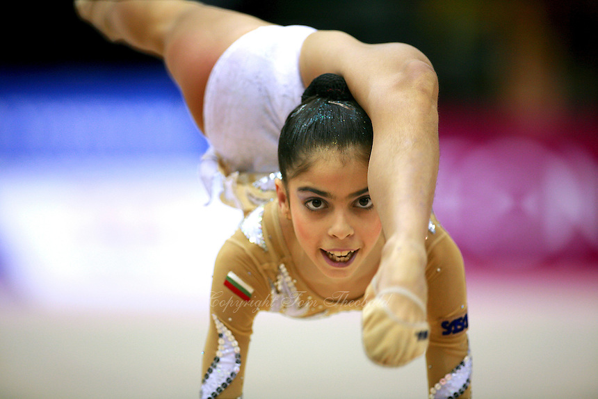 Filipa Siderova of Bulgaria holds flexibility balance near carpet at 2006 Aeon Cup Worldwide Clubs Championships in rhythmic gymnastics on November16, 2006.<br />