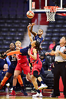 Washington, DC - June 3, 2018: Connecticut Sun guard Courtney Williams (10) jumps over Washington Mystics forward Monique Currie (25) to make a play on the ball during game between the Washington Mystics and Connecticut Sun at the Capital One Arena in Washington, DC. (Photo by Phil Peters/Media Images International)
