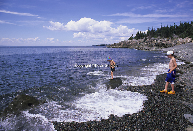 Two boys at a gravel beach in Acadia National Park, Isle Au Haut, Maine, USA