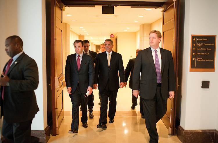 UNITED STATES - OCTOBER 13:  Speaker John Boehner, R-Ohio, and his staff leave his weekly news conference in the Capitol Visitor Center where he spoke about job creation and the work of the Joint Select Committee on Deficit Reduction.  (Photo By Tom Williams/Roll Call)