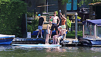 People were out and about enjoying the UK's heatwave as the hot weather is expected to see temperatures reach 90F and last until the weekend at least. Henley-on-Thames, UK 23rd June 2020<br />