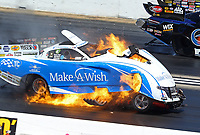 Jun 3, 2018; Joliet, IL, USA; NHRA funny car driver Tommy Johnson Jr explodes his engine on fire during the Route 66 Nationals at Route 66 Raceway. Johnson would be uninjured in the explosion. Mandatory Credit: Mark J. Rebilas-USA TODAY Sports
