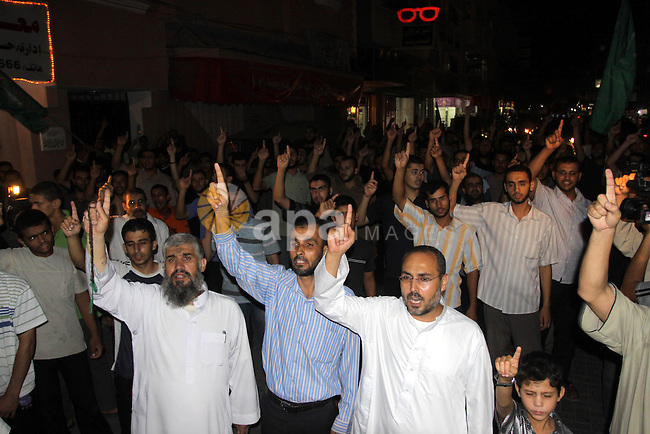 Palestinians, supporters of the Islamic Hamas group, raise their right index fingers in the air as a sign of loyalty to the group during a rally, to celebrate a militant attack in the southern West Bank, in the Jebaliya Refugee camp in the northern Gaza Strip, Tuesday, Aug. 31, 2010. A Palestinian gunman opened fire on an Israeli vehicle traveling in the West Bank on Tuesday, killing four passengers, authorities said, in a deadly attack that cast a long shadow over Mideast peace talks set to start this week. Photo by Mohammed Asad