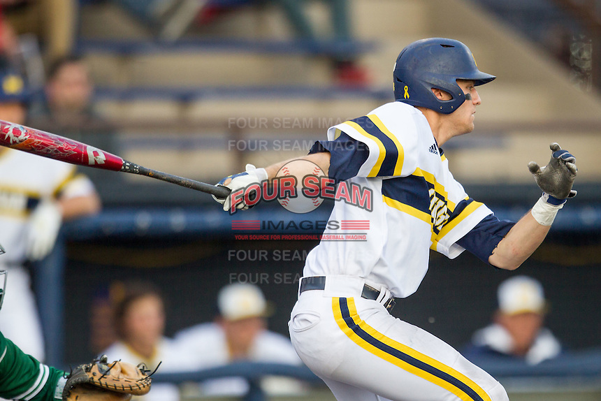 Michigan Wolverines third baseman Jake Bivens (18) follows through on his swing against the Eastern Michigan Hurons on May 3, 2016 at Ray Fisher Stadium in Ann Arbor, Michigan. Michigan defeated Eastern Michigan 12-4. (Andrew Woolley/Four Seam Images)