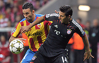 19.09.2012. Munich, Germany.  Munichs Claudio Pizarro (r) and Sofiane Feghouli of Valencia challenge for the ball during the UEFA Champions League group F soccer match between Bayern Munich and Valencia CF at the football  Arena M in Munich, Germany, 19 September 2012.