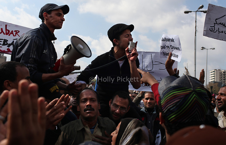 A protester uses a megaphone to sing the Muslim call to prayer at midday on Tahrir Square, Cairo, Egypt, Jan. 31, 2011. Demonstrations against the regime of Hosni Mubarak continued for a seventh day in the Arab World's most populous nation.