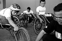 Athletes are setting up their wheelchair before the race taking place in Kompong Cham, Cambodia - 2009