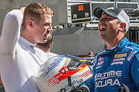 Chris Dyson, L, and Ryan Eversely share a laugh before the Pirelli World challenge race, Long Beach Grand Prix, Long Beach, CA, April 2015.  (Photo by Brian Cleary/ www.bcpix.com )