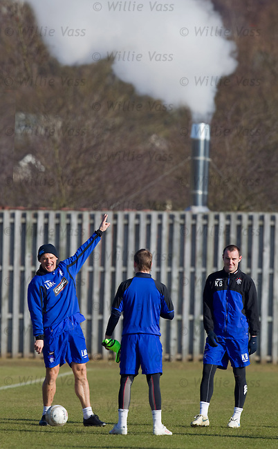 Lee McCulloch laughing and pointing at training.