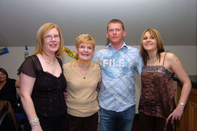 Stella Reilly celebrating her 60th birthday in the Bridgeford with her daughters Ann and Laura and son Stephen. Photo: Colin Bell / Newsfile