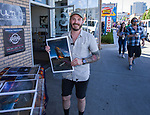 Photographer Richard Moore with one of his photos at the Midtown Art Walk on Thursday afternoon in Reno, June 28, 2018.
