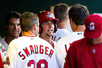 Greg Garcia (10) of the Springfield Cardinals is congratulated by teammates in the dugout after hitting a home run during a game against the Arkansas Travelers at Hammons Field on May 5, 2012 in Springfield, Missouri. (David Welker/Four Seam Images)