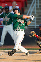 Justin Bass #14 of the Greensboro Grasshoppers follows through on his swing against the Hickory Crawdads at  L.P. Frans Stadium July 10, 2010, in Hickory, North Carolina.  Photo by Brian Westerholt / Four Seam Images