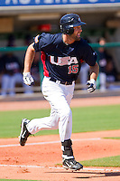 Jordan Danks #15 of the United States World Cup/Pan Am Team hustles down the first base line against Team Canada at the USA Baseball National Training Center on September 29, 2011 in Cary, North Carolina.  (Brian Westerholt / Four Seam Images)