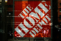 New York, USA. 19 August 2014. People is reflected on a window of a  Home Depot store at 23rd street while Home Depot company prepares its Quarterly results at the Stock Exchange in New York.  Eduardo Muñoz Alvarez/VIEWpress