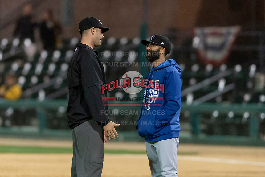 Rancho Cucamonga Quakes manager Mark Kertenian argues a call with field umpire Ty Kraus during a California League game against the Visalia Rawhide on April 9, 2019 in Visalia, California. Visalia defeated Rancho Cucamonga 8-5. (Zachary Lucy/Four Seam Images)