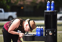 NWA Democrat-Gazette/DAVID GOTTSCHALK Dot Neely, education coordinator with Beaver Water District, takes a drink Monday, September 9, 2019, prior to a ceremony celebrating the installation of a hydration station in Sweetbriar Park in Fayetteville. Beaver Water District partnered with the city of Fayetteville to make the new hydration station in the park that is located near a newly completed section of the Niokaska Creek Trail.