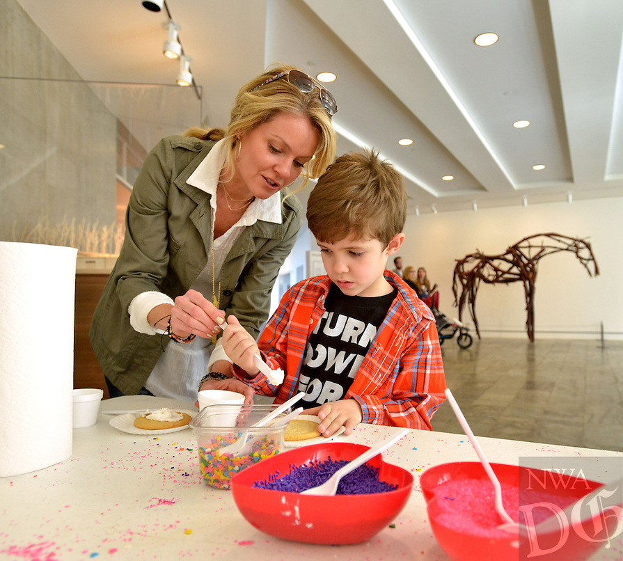 NWA Democrat-Gazette/BEN GOFF -- 02/08/15 Tami Kirkpatrick and son Colt Kirkpatrick, 7, of Springdale decorate sugar cookies in the Sweet Treats station in the South Lobby at Crystal Bridges Museum of American Art in Bentonville on Sunday Feb. 8, 2015. The station was a part of the museum's Family Sunday: I Heart Art event, which also included drop-in art making, a fancy photo booth, gallery scavenger hunt and a Mr. Stinky Feet family concert.