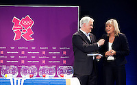 30 MAY 2012 - LONDON, GBR - Commentator Paul Bray (left) asks Debbie Jevons, LOCOG Director of Sport, her thoughts on this summer's handball competition during the London 2012 Olympic Games Handball Draw at the National Sports Centre in Crystal Palace, Great Britain (PHOTO (C) 2012 NIGEL FARROW)