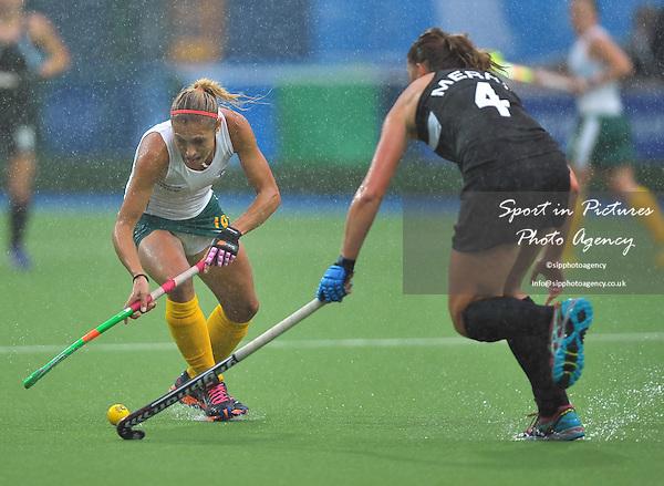 Shelley Russell (RSA) and Olivia Merry (NZL). South Africa (RSA) v New Zealand (NZL). Womens bronze medal match. Hockey. PHOTO: Mandatory by-line: Garry Bowden/SIPPA/Pinnacle - Tel: +44(0)1363 881025 - Mobile:0797 1270 681 - VAT Reg No: 183700120 - 020814 - Glasgow 2014 Commonwealth Games - Glasgow national hockey centre, Glasgow, Scotland, UK