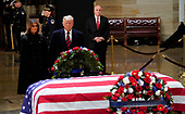 President Donald Trump and first lady Melania Trump pay their respects to former President George H. W. Bush lying in state in the U.S. Capitol Rotunda Monday, Dec. 3, 2018, in Washington. (AP Photo/Pablo Martinez Monsivais/Pool)