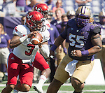 Washington Huskies'  Danny Shelton (55) chases Eastern Washington Eagles' quarterback Vernon Adams Jr. (3) at Husky Stadium September 6, 2014 in Seattle. Huskies out lasted the Eagles in a high powered shootout 59-52 in the third highest scoring game in Husky history. Adams passed for 475 yards, 7  touchdowns and rushed for 43 yards.  ©2014. Jim Bryant  Photo. All Rights Reserved