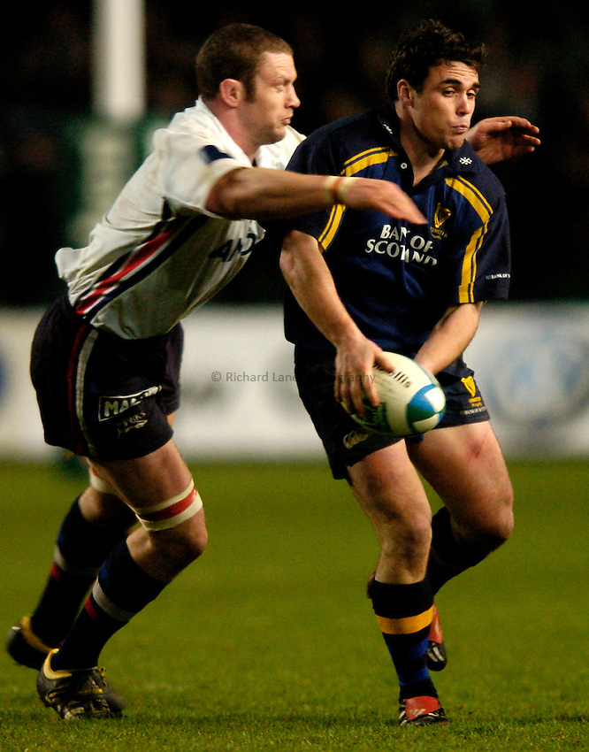 Photo: Richard Lane..Leinster Lions v Sale Sharks. Heinenken Cup. 09/01/2004..Matt Leek is tackled by Jason White.
