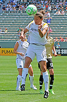 Stephanie Cox #14 of the Los Angeles Sol heads a loose ball against the defense of FC Gold Pride during their match at Home Depot Center on April 19, 2009 in Carson, California.