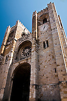 Front of Lisbon's Cathedral, Lisbon, Portugal.  The construction of Lisbon's Cathedral started in 1147. During the centuries, and due to several major earthquakes shaking Portugal's capital city, the building got substantially damaged and needed significant renovation. Although thought as a place of worship, the constant battles and threats coming from the south meant that the cathedral was a last line of defense, and thus its fortified architecture. Nowadays, it is still used as the main place of worship in the city, and a must visit site for tourists.