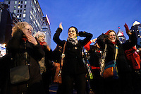 New York, United States. 14th February 2013 -- People take part during One Billion Rising campaign, hundreds of women dance together to call for an end to violence against women in New York . by VIEWpress.Photo by Kena Betancur