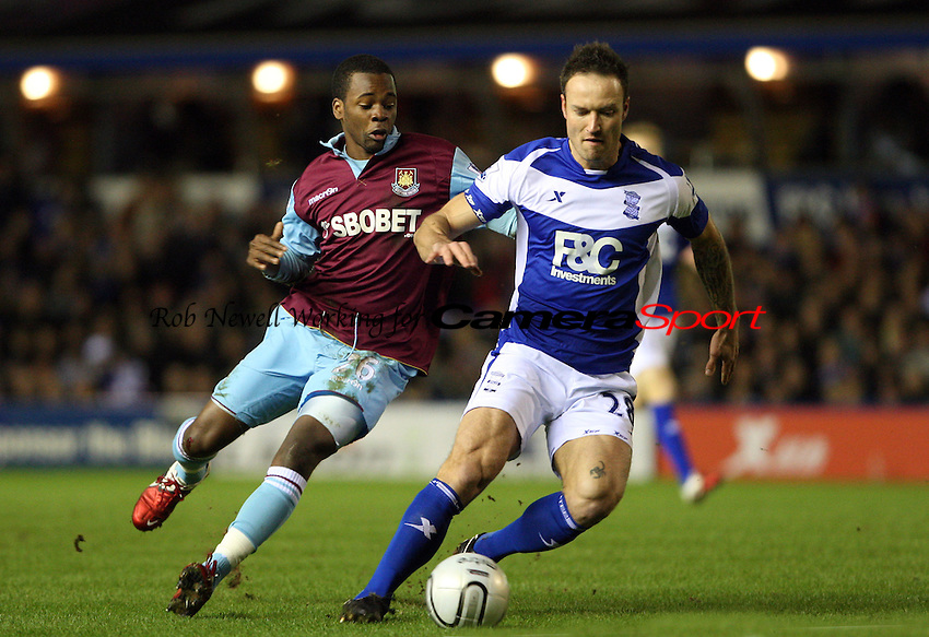 Zavon Hines of West Ham and Martin Jiranek of Birmingham - Birmingham City vs West Ham United, Carling Cup Semi-Final 2nd leg at St Andrews, Birmingham - 26/01/11 - MANDATORY CREDIT: Rob Newell/TGSPHOTO - Self billing applies where appropriate - 0845 094 6026 - contact@tgsphoto.co.uk - NO UNPAID USE.