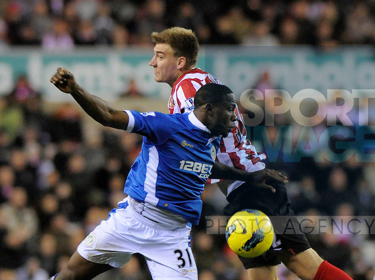 Maynor Figueroa  of Wigan Athletic (L) and Nicklas Bendtner of Sunderland AFC during the Premier League football match between Sunderland AFC and Wigan Athletic on 26 November 2011, at Stadium of Light, Sunderland, England.