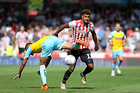 Ollie Watkins of Brentford takes the ball past Rotherham's Zak Vyner during Brentford vs Rotherham United, Sky Bet EFL Championship Football at Griffin Park on 4th August 2018