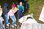 People walking down the Old Mill road getting scared by all the monsters, zombies and witches at the Knocknagoshel Halloween festival on Sunday night