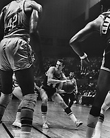 San Francisco Warriors vs. Los Angeles Lakers, guard Jerry West between Nate Thurman and Wilt Chamberlain. (1969 photo/Ron Riesterer/Photoshelter)