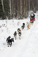 Lachlan Clarke w/Iditarider on Trail 2005 Iditarod Ceremonial Start near Campbell Airstrip Alaska SC