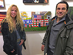 "Huntington, New York, USA. March 5, 2017. Eileen Fuscaldo and her husband, next to 2016 photo of Eileen, at Opening Reception for ""Her Story Through Art"" Invitational Art Show, celebrating Women's History Month, at Huntington Arts Council, Main Street Gallery. Artists Tara Leale Porter, Irene Vitale, Anahi DeCanio, Ann Parry, Show March 2 - 25, 2017."