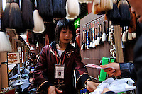 A shop selling Chinese calligraphic brushes that are of artistic value in Yu Yuan Bazaar shopping district in Shanghai, China.These brushes come in all different sizes and they are the traditional writing instrument for writing Chinese characters..18 Nov 2005