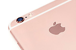 Closeup of Apple logo on rose gold iPhone 6s smartphone device isolated on white background