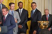 United States President Barack Obama (2-R), enters beside U.S. golfer Tiger Woods (3-L), U.S. golfer Zack Johnson (2-L), PGA Tour Commissioner Tim Finchem (L) and U.S. Vice President Joe Biden (R), at an event hosting the 2013 Presidents Cup Team in the East Room of the White House in Washington DC, USA, 24 June 2014.<br /> Credit: Michael Reynolds / Pool via CNP