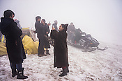 Tourists take photos while it snows on Rohtang Pass enroute the Leh-Manali highway.