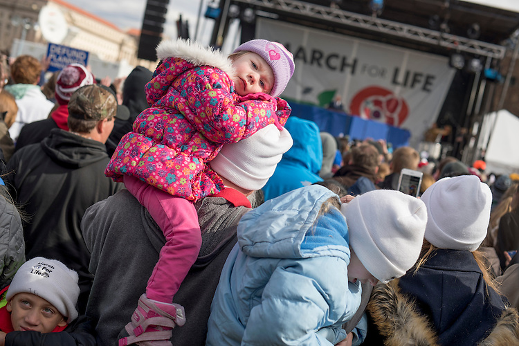 UNITED STATES - JANUARY 27: Vice President Mike Pence speaks near the base of the Washington Monument as Katharine Hanks, 4, of Louisiana, looks on, during the annual March for Life, January 27, 2017. Attendees march from the monument to Capitol Hill to oppose abortion. (Photo By Tom Williams/CQ Roll Call)