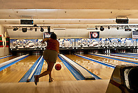 Woman bowling.