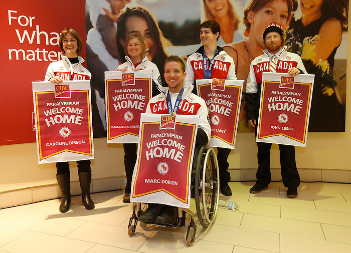Ottawa, ON - March 28 2014 - Ottawa's Sochi Paralympians after receiving their CIBC Welcome Home banners – back row: Caroline Bisson (para-Nordic skiing and biathlon), Margarita Gorbounova (para-Nordic skiing and biathlon), bronze medallist Ben Delaney (sledge hockey), John Leslie (para-snowboard). Front: Bronze medallist Marc Dorion (sledge hockey)(Photo: Patrick Doyle/CIBC)