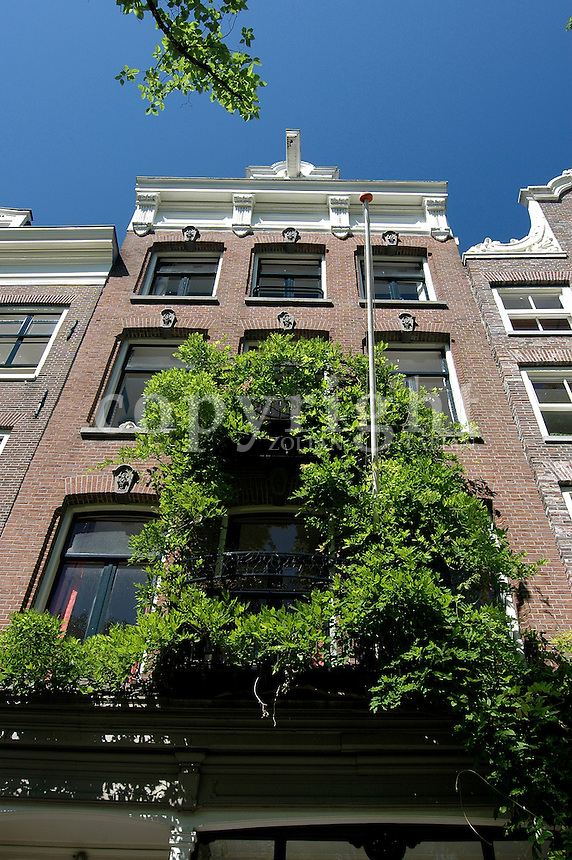 Facade of a house  in Amsterdam, The Netherlands, Europe