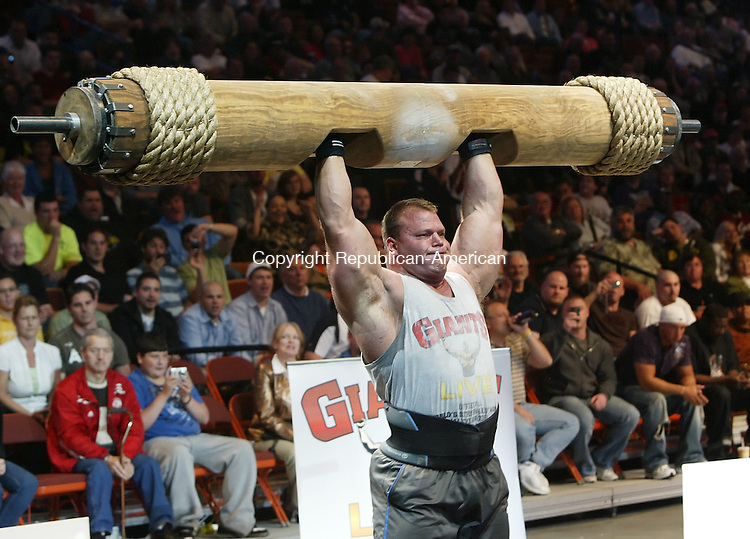 UNCASVILLE, CT 05/17/09- 051709BZ04- Waterbury's Derek Poundstone, left, successfully completes one of his 9 lifts in the Giant Log Press event during the World's Strongest Man qualifier at the Mohegan Sun Arena Sunday. Poundstone won this event and the overall event title.<br /> Jamison C. Bazinet Republican-American