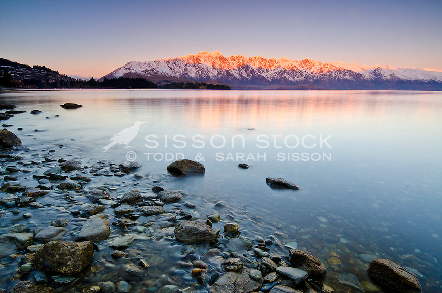 Sunset on snow covered Remarkables, from Lake Wakatipu, Winter, Queenstown, New Zealand