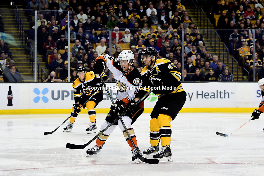 Thursday, December 15, 2016: Anaheim Ducks defenseman Cam Fowler (4) battles Boston Bruins center David Krejci (46) during the National Hockey League game between the Anaheim Ducks and the Boston Bruins held at TD Garden, in Boston, Mass. The Ducks beat the Bruins 4-3 in regulation time. Eric Canha/CSM