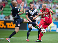 MELBOURNE, AUSTRALIA - JANUARY 09: Kevin Muscat and Rodrigo Vargas of the Victory blocks a kick by Sergio van Dijk of United  during the round 22 A-League match between the Melbourne Victory and Adelaide United at AAMI Park on January 9, 2011 in Melbourne, Australia. (Photo by Sydney Low / Asterisk Images)