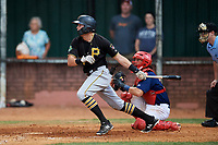 Bristol Pirates right fielder Conner Uselton (25) follows through on a swing during in front of catcher Trevor Casanova (33) and home plate umpire Adam Pierce a game against the Elizabethton Twins on July 29, 2018 at Joe O'Brien Field in Elizabethton, Tennessee.  Bristol defeated Elizabethton 7-4.  (Mike Janes/Four Seam Images)